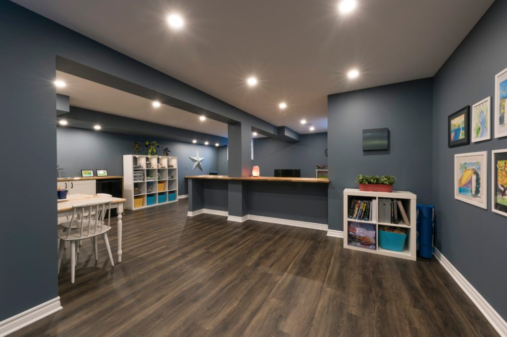 Basement remodeling can be a scary process. With so many options, it can be challenging to feel like the right choice has been made. Looking at some incredible basement remodeling ideas is an excellent way to deal with that fear and find something that everyone will genuinely love. Read on to learn five of the most fantastic basement remodeling ideas to transform a basement, featuring specific tips to make the space shine. Create A Cozy Second Living Room Creating a second living room area is a common use for a basement remodel. However, there are so many options with a remodel of this type that it can never go out of style. Rather than focusing on just creating a living room, consider all of the extra options to make the space shine. Basement living rooms work best with additional features that are missing from the main living area. This should be your focus. Why make just a second living room when you can make a living room that serves different purposes? These extras can make or break a basement remodel. Consider what you already have upstairs, as well as the layout and light of the basement, before moving on. Some popular choices that fit into a second living room include: A library or reading nook Game area Children's area or playpen A game-day spot Music corner Ultimately, every choice you make should be something that will see use or bring you joy. Something that draws you or guests down to the second living space is always welcome. To start, a game area - whether for adults or children - is often a safe choice. Separating space, even slightly, is an excellent way to make the basement living area feel more organized and unique - two great features. Normal tips about living room organization and flow hold here, as well. Choosing A Style Choosing a style for your basement living room is essential. Whether you prefer a sophisticated and classy look or a charmful and cozy one, it is important to dedicate yourself to it. The more you enjoy a space, the more likely